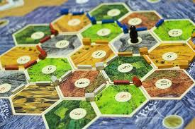 settlers of catan randomness mobile app game design multiplayer game